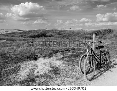 Two bicycles in countryside. Brittany, France. The concept of romance, love and simple everyday life. Aged photo. Black and white. - stock photo