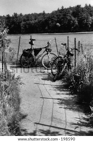Two bicycles on a dirt path at Walden Pond - stock photo