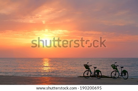 Two bicycles on Batumi beach, sunset  - stock photo