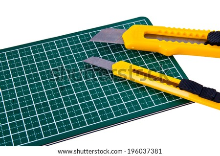 Two Big and Small Stationery Knife Paper Cutter isolated on a white background. Concept Idea of Art and Craft.