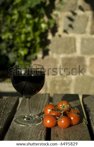 Two big italian products - wine and tomatoes - stock photo