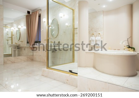 Two big mirrors in enormous luxury bathroom