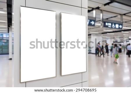 Two big vertical / portrait orientation blank billboard in public transport - stock photo
