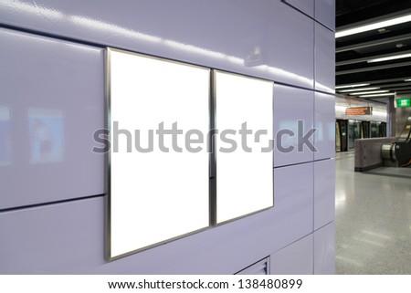 Two big vertical / portrait orientation blank billboard on light purple wall - stock photo