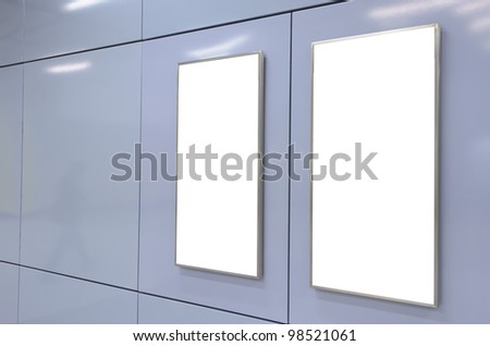 Two big vertical / portrait orientation blank billboard on modern blue wall - stock photo