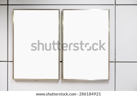Two big vertical / portrait orientation blank billboard on modern white wall - stock photo