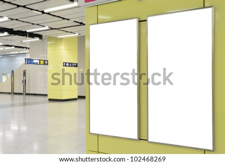 Two big vertical / portrait orientation blank billboard on modern yellow wall with corridor background - stock photo