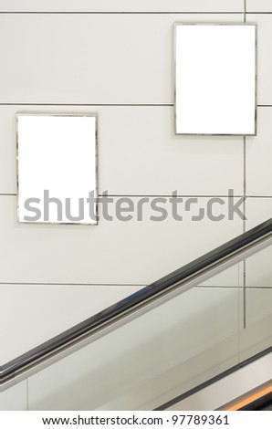 Two big vertical / portrait orientation blank billboard with escalator background - stock photo