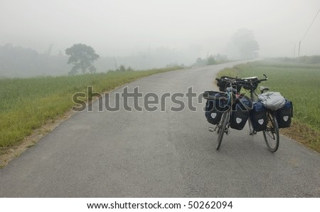 Two bikes standing at a side of a road, China - stock photo