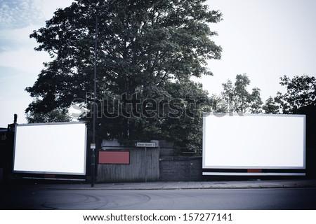 Two billboards on corner - stock photo