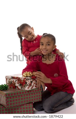 Two Biracial girls posing for a Christmas portrait. - stock photo