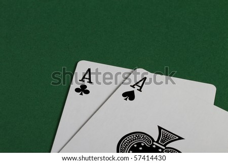 two black aces on green background - stock photo