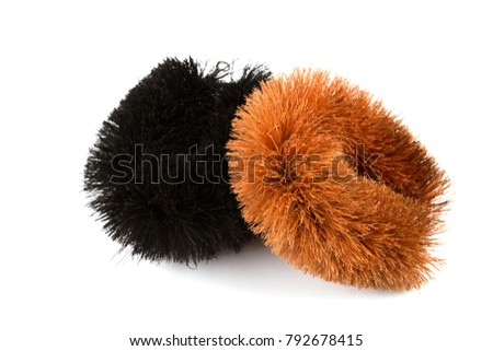 Two Black and brown Natural Coconut Fiber Brush or Coir Fiber Vegetable Brush without handle for polishing and cleaning isolated on white background.