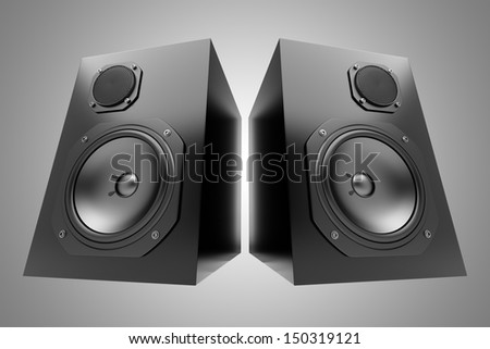 two black audio speakers isolated on gray background