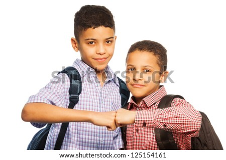 Two black boys a team, brotherhood - schoolboys with backpacks isolated on white - stock photo
