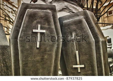 Two black coffin and white cross. - stock photo
