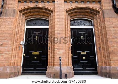 Two Black Doors - stock photo