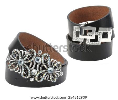 two black female belts isolated on white - stock photo