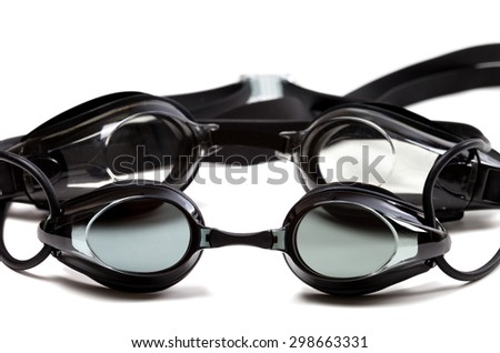 Two black goggles for swimming isolated on white background - stock photo
