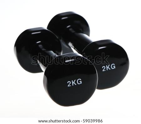 Two black 2 kg dumbels - stock photo