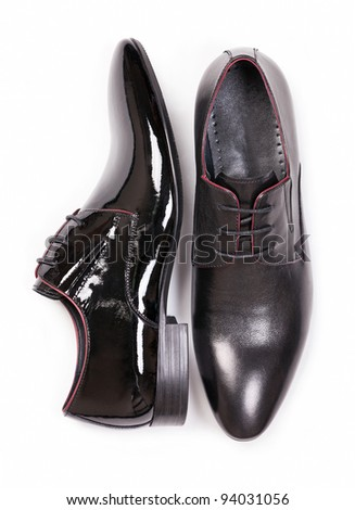 Two black men shoes against white background, view from above - stock photo
