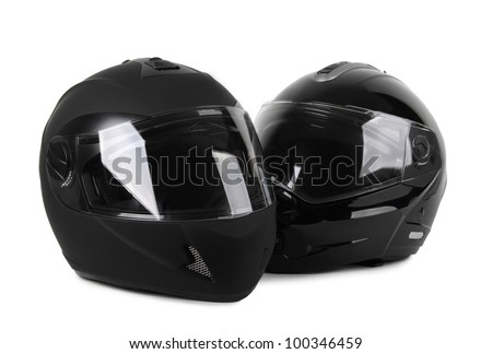 two black motorcycle helmets isolated - stock photo
