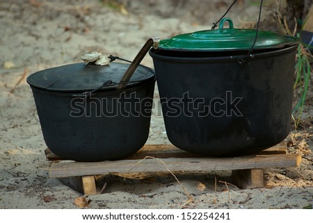two black pot with food, camping, outdoor activities - stock photo