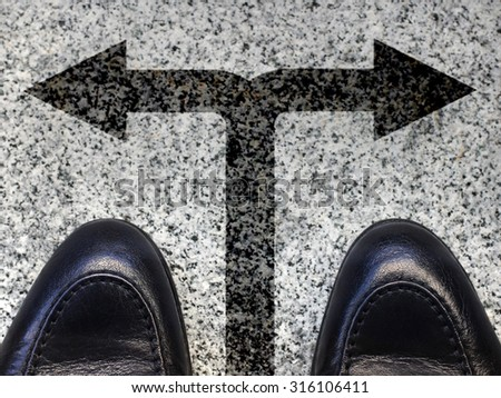 two black shoes and indecision - stock photo