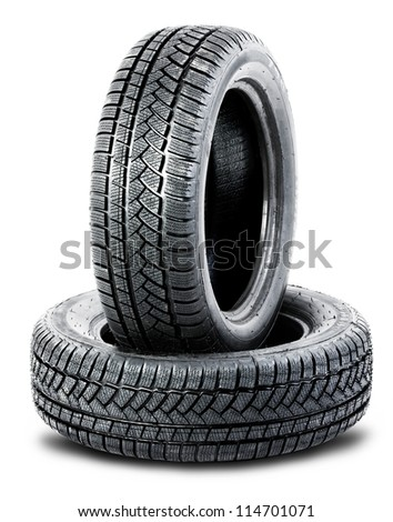 two black tires on the white background - stock photo
