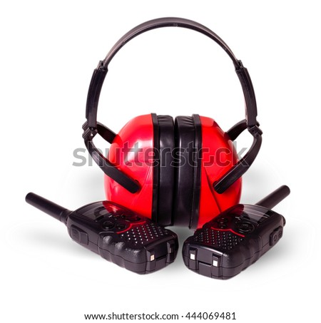 two black walkie-talkie antennas red earmuffs, cut out on white background - stock photo