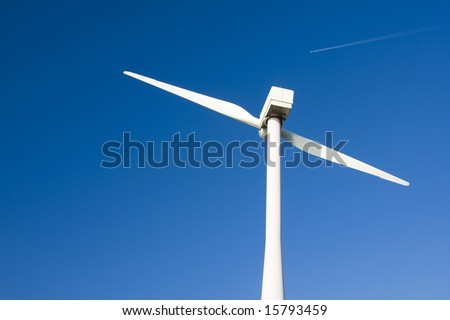 Two Bladed Windmill Against a Blue Sky - stock photo