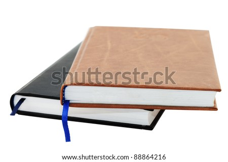 Two blak and brown notebooks isolated on white background - stock photo