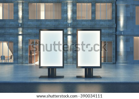 Two blank ad banners at night with concrete building in the background, mock up, 3D Render - stock photo