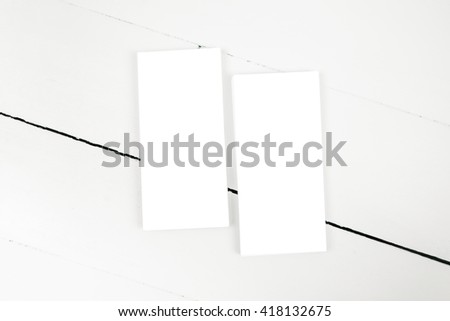 two blank flyers on painted wooden surface, top view