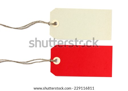 Two blank gift tags in creme and red color with natural string - isolated on white background - stock photo