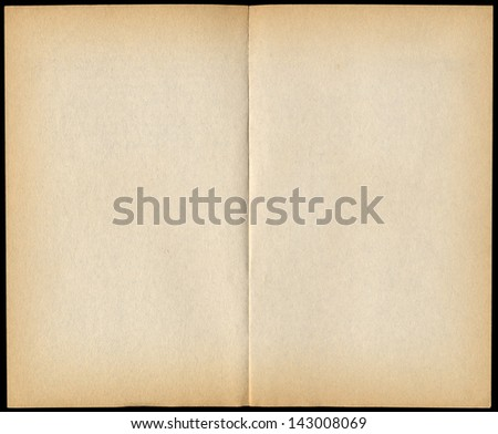 Two blank vintage paperback book pages isolated on black. - stock photo
