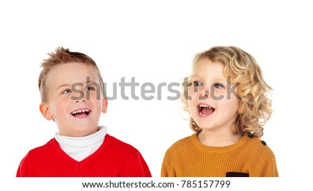 Two blond children laughing isolated on a white backround