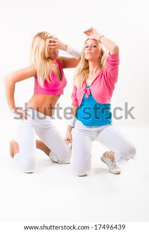 two blond woman dancing, isolated on white - stock photo