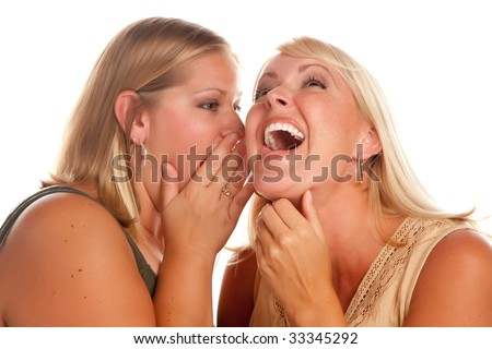 Two Blonde Woman Laughing Whispering Secrets Isolated on a White Background. - stock photo