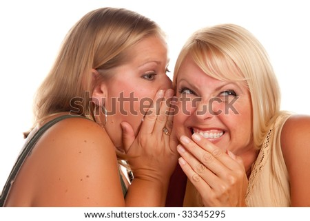 Two Blonde Woman Whispering Secrets Isolated on a White Background.