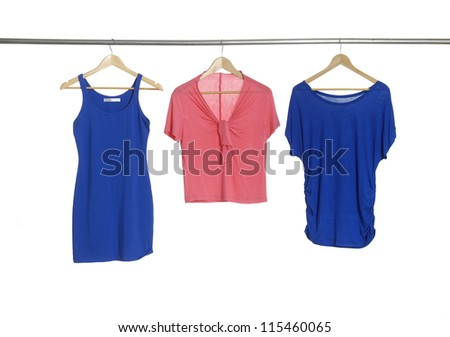 Two blue and red female cloth hangers - stock photo