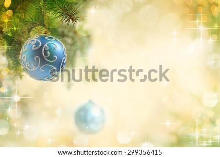 Two Blue Balls on the Christmas Tree at the Defocused Lights Background . - stock photo