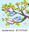 Two blue birds sitting in a tree and looking at each other. - stock photo