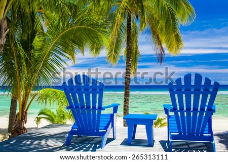 Two blue chairs on a beach front on amazing beach, Cook Islands - stock photo