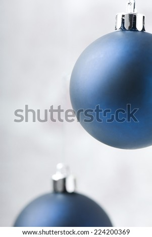 Two blue Christmas tree ornaments - stock photo
