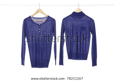 Two blue clothes on a hanger studio isolated - stock photo