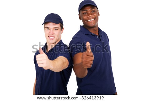 two blue collar co-workers giving thumbs up - stock photo