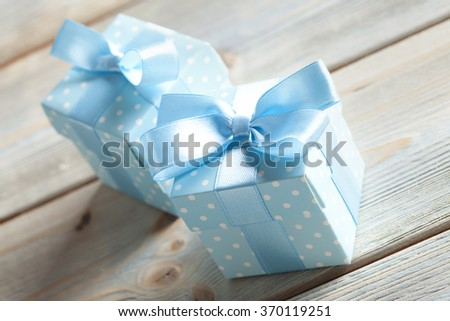 Two blue gift boxes on wood - stock photo