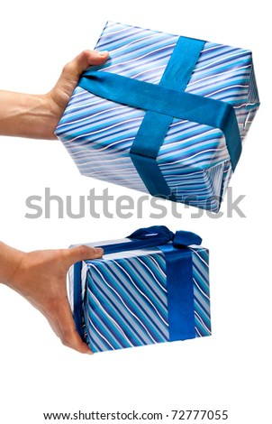 Two blue gifts boxes in man's hands. Isolated on white - stock photo