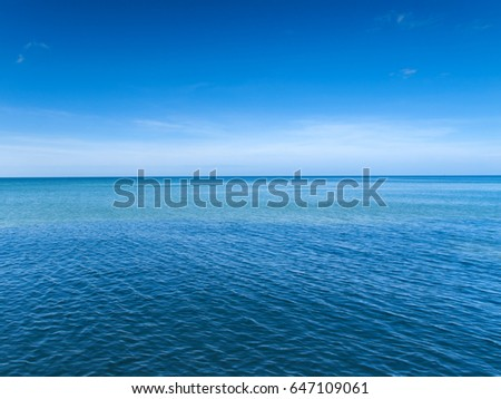 Two blue halves. Blue ocean and blue sky in tropical Thailand